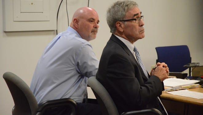 David Hursley, left, and his attorney, J. Thomas Schaeffer listen to the jury verdict.