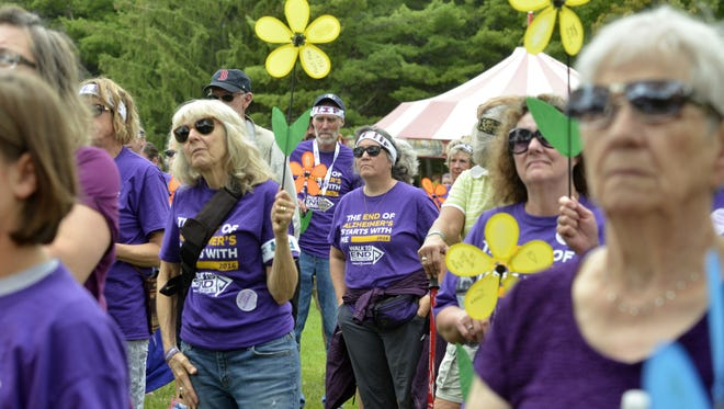 Participants in the Walk to End Alzheimer's listen to the opening ceremony at the Shelburne Museum on Sunday, Sept. 18, 2016.