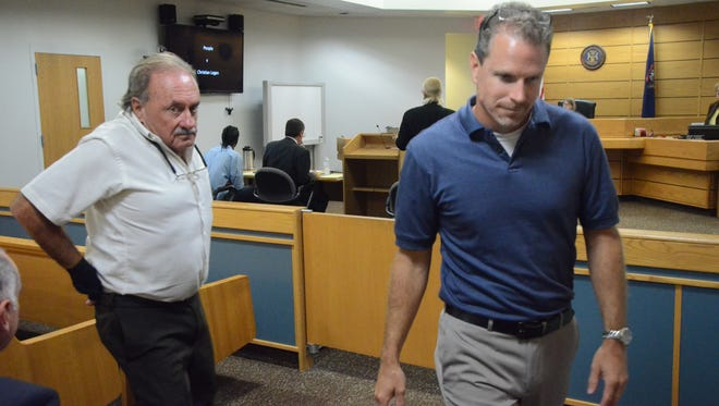 Jon Vanderwiel, right, and his father, Robert Vanderwiel leave the courtroom after testifying Wednesday.