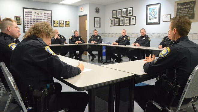 Battle Creek Police Department officers meet at the start of their shift on Tuesday. Pension benefits for employees are an increasing burden on the city budget.