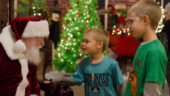 Children meet Santa Claus at the 12th Annual Olde Fashioned Christmas Festival in the Historic Depot District in Richmond, Ind. on Tuesday, Nov. 29, 2016.