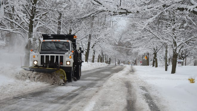 A city plow works to clear snow on Sherman Road in 2015.