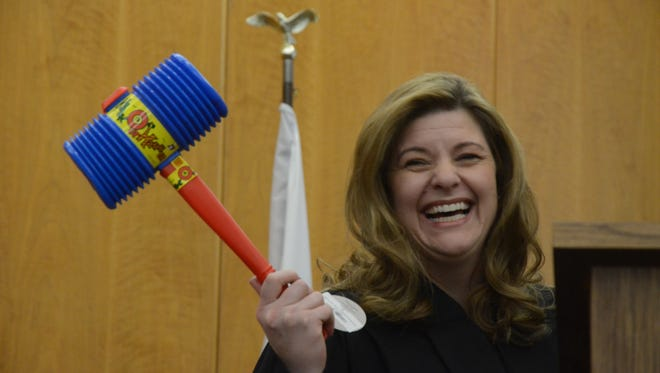 Judge Tina Yost Johnson was given a really big gavel at her investiture Friday.
