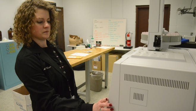 Amy Maile, a forensic specialist with the Battle Creek Police Department uses a gas chromatography mass spectrometer to test drugs seized by officers.