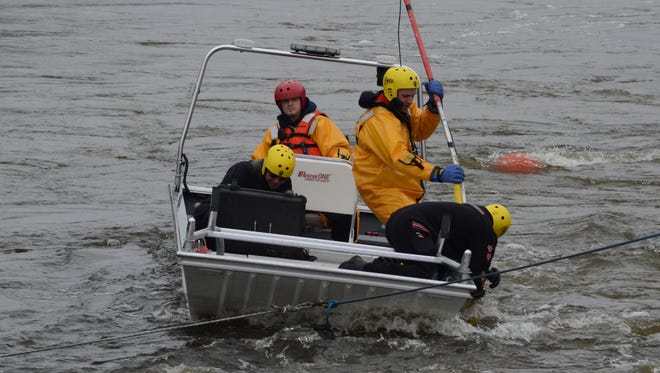 Searchers put a camera into the water Monday.