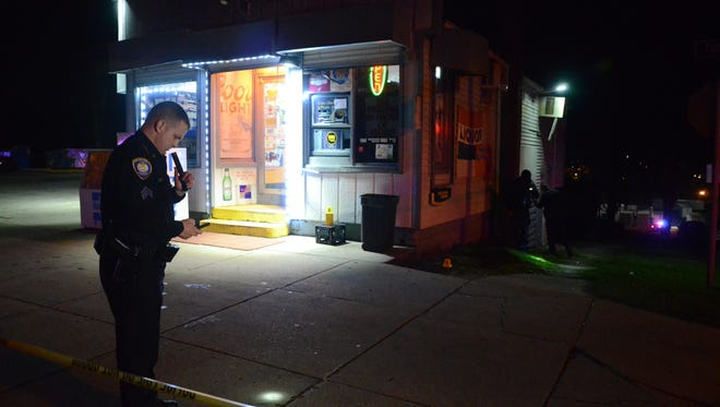 Battle Creek Police Sgt. Todd Elliott stands outside Cliff Street Grocery, where one man was shot Tuesday night.