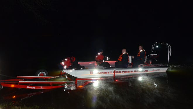 A team from Battle Creek Fire Department and Emmett Township Department of Public Safety launches a boat after a body was discovered Sunday in the Kalamazoo River.