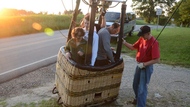 Kate Conzelmann and the balloon are back on the ground after a flight of 1 hour and 15 minutes.