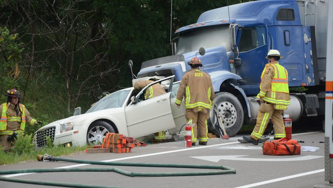 A woman was injured when her car was struck by a semi on M-66 in Battle Creek Thursday.