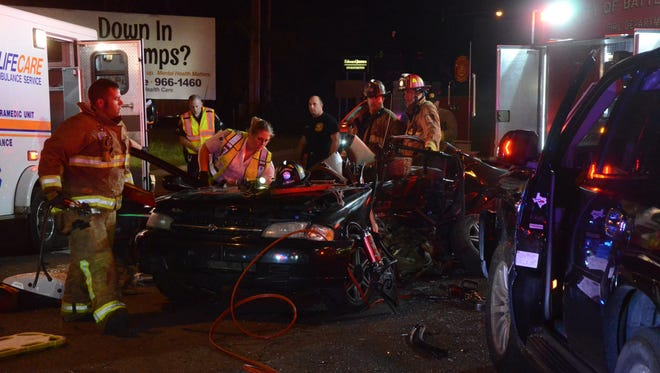 Battle Creek firefighters had to use power tools to cut away the wreckage to free two people from a vehicle.
