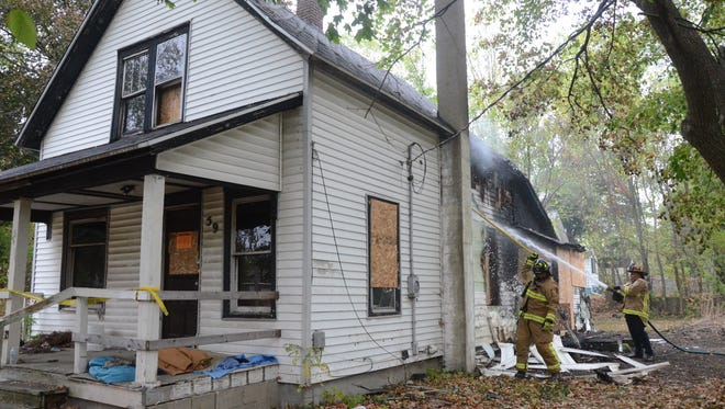 Firefighters returned to 59 E. Territorial Road late Wednesday morning, Oct. 4, 2017 when the fire rekindled.