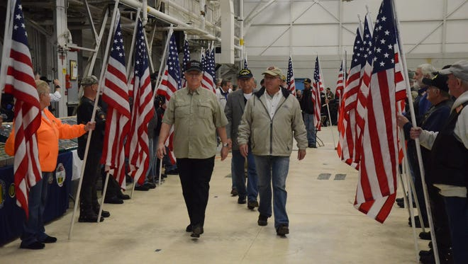 Vietnam veterans entered the ceremony between American flags and to applause.