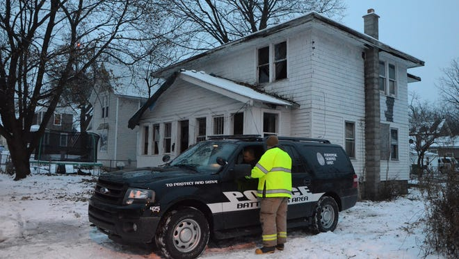Battle Creek police were investigating a fire which damaged this vacant house at 124 Meachem Ave. early Wednesday.