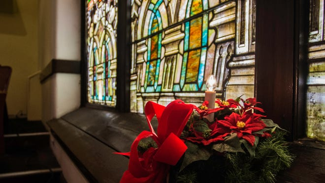 Christmas decor sits in the sanctuary of St. John's Luterhan Church, 501 S. Seventh St., on Tuesday, Dec. 12, 2017.