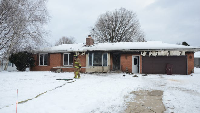 Fire heavily damaged this home Friday at 171 Sherwood  Drive on Battle Creek's south side.