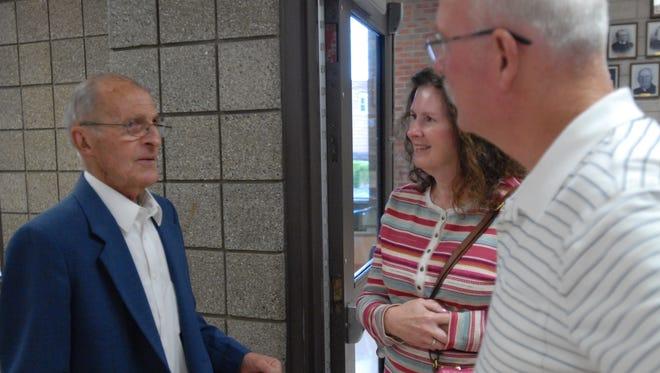 Ed Terhune, center, speaks with Kathy and Don Schweihofer. Terhune is retiring after 73 years at Terhune Sales & Service.