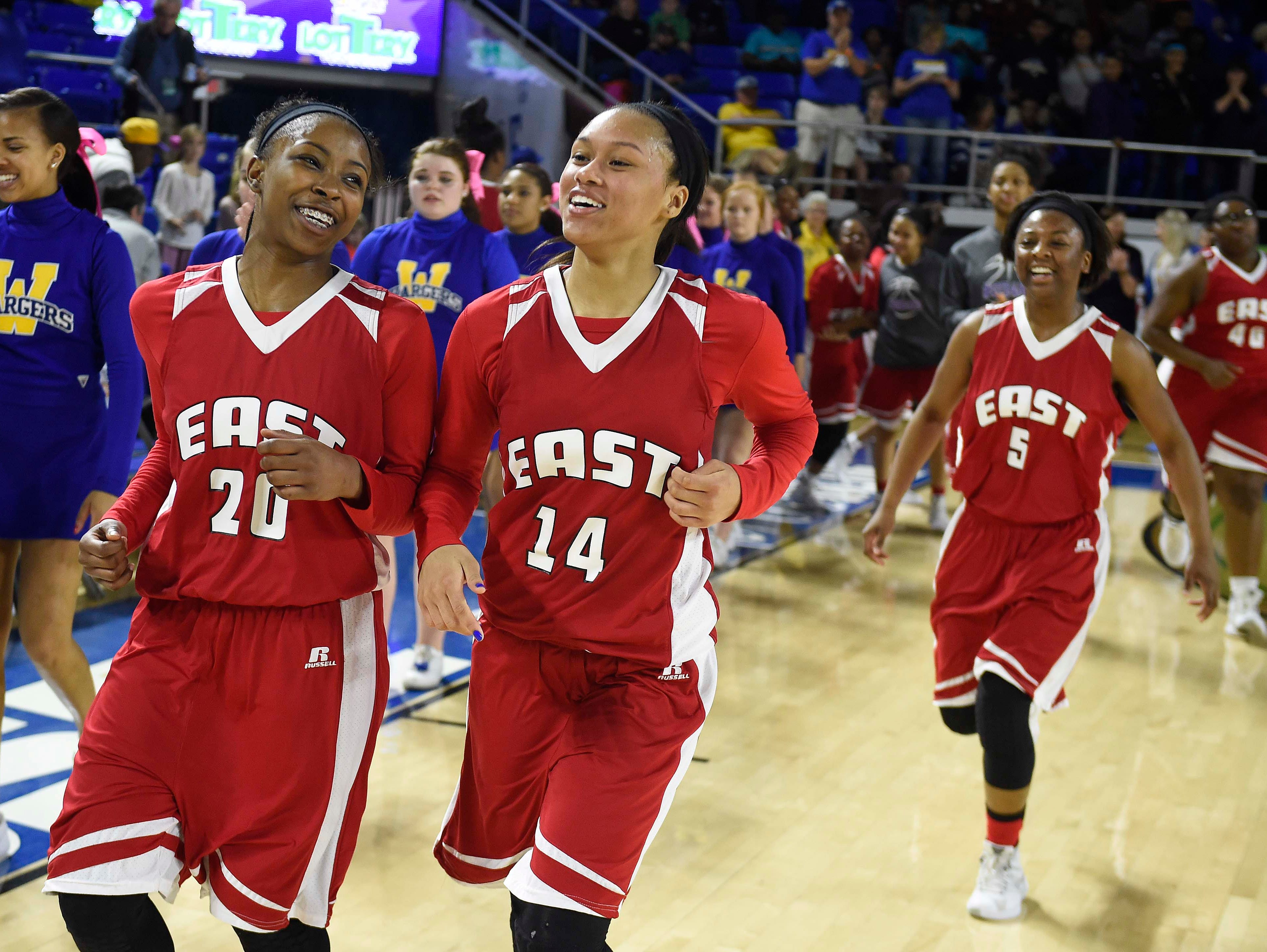 East's Erica Haynes-Overton (20) and Kaia Upton (14) celebrate as they win over Westview High School 35-32 in the Division I Class AA Girl's basketball semi-finals at the Murphy Center on MTSU's campus March 11, 2016 in Murfreesboro, Tenn.