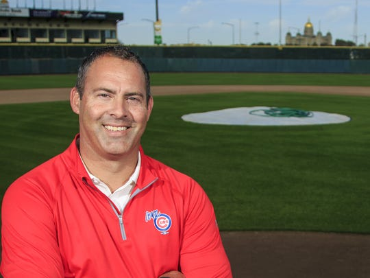 Iowa Cubs assistant general manager Nate Teut stands