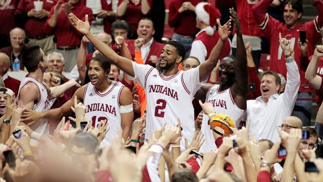 Indiana's Christian Watford (2) celebrates with teammates, from left, Will Sheehey, Verdell Jones III and Victor Oladipo after Indiana defeated Kentucky 73-72 in an NCAA college basketball game, Saturday, Dec. 10, 2011, in Bloomington, Ind. Watford hit a 3-pointer at the buzzer to seal the victory.