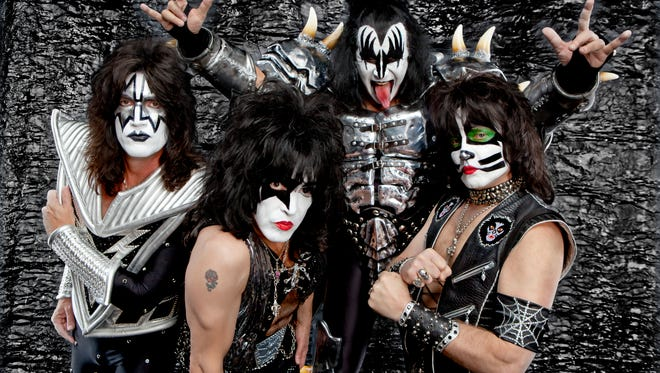Members of KISS pose for a photo.