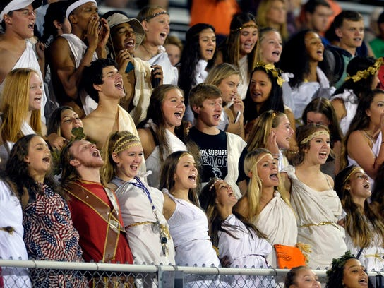 The York Suburban student section cheers in the second half of a YAIAA high school football game Friday, Sept. 18, 2015, at York Suburban. York Suburban defeated Spring Grove 29-22 to win its first home game in the third week of the season. Chris Dunn Ñ Daily Record/Sunday News