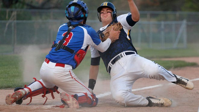 Mason catcher Chase Johnston, left, tags out Haslett's Brock Pringle at home plate Tuesday, May 24, 2016, at Kircher-Municipal Park.