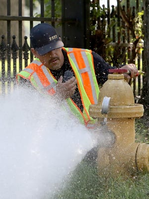 Firefighter, Channing Chronister, Fort Smith Fire Department, Pumper 4, test the water flow capacity and operation of a hydrant on S. O St, Monday, August 3, 2020, as part of the fire department's hydrant inspections across the city The testing will be done in a rotation through five districts across the city and will be conducted 8 a.m - 3:30 p.m. Each rotation should take 1-2 weeks and customers may experience a temporary discoloration of water, which is due to the unsettling of rust in the water main.