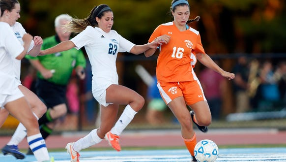 Suffern's Jackie Santangelo (23) looks to take the