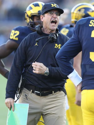 University of Michigan Wolverines head coach Jim Harbaugh reacts to a call on a Chris Evans run against the Maryland Terrapins on Saturday, Nov. 5, 2016 at Michigan Stadium.