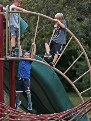 Kids play during their short 15-minute recess at Cherry Tree Elementary School, Monday, August 21, 2017.