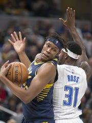 Myles Turner of Indiana turns as he is fouled by Terrence Ross of Orlando Magic at Indiana Pacers, Bankers Life Fieldhouse, Indianapolis, Monday, Nov. 27, 2017.