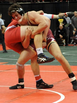 Licking Heights senior L.A. Kelly wrestles Cincinnati LaSalle's Garrett Bledsoe this past Saturday during a Division I 195-pound consolation match at Ohio State's Value City Arena.