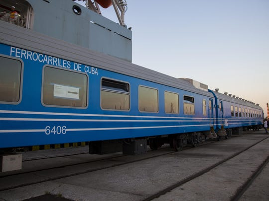 In this Monday, May 20, 2019 photo, new railroad passenger cars brought from China are inspected at their arrival in Havana, Cuba.