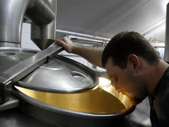 Brent Cordle checks on the brewing process at Odell