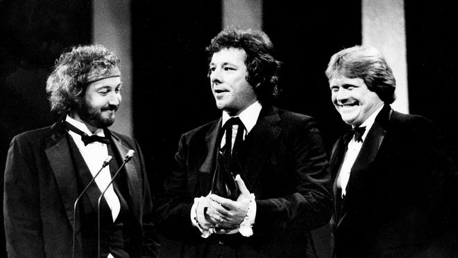 """Songwriters Johnny Christoper, left, Wayne Carson and Mark James accept the trophy for winning the Song of the Year for """"Always on My Mind"""" during the CMA Awards show Oct. 11, 1982. Willie Nelson, who wasn't at the show, picked up the Single of the Year for the same song. Nelson also won the Album of the Year for """"Always on My Mind."""" Carson died early Monday after a lengthy illness."""