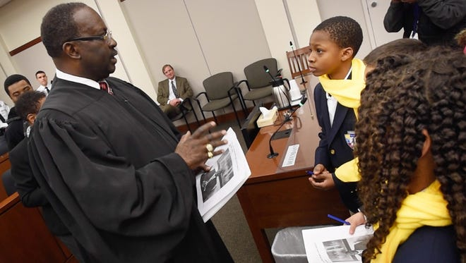 District Judge James Morgan addresses children from Lincoln Charter School about how they are the future for fixing the problems in York. Morgan was sworn in on Wednesday during a ceremony at the York County Judicial Center.