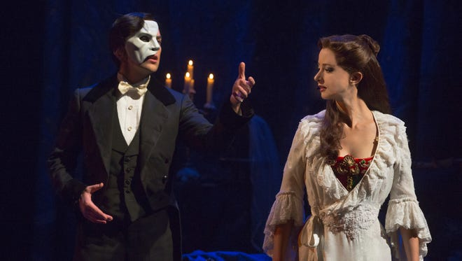 "Chris Mann and Katie Travis in ""The Phantom of the Opera."""