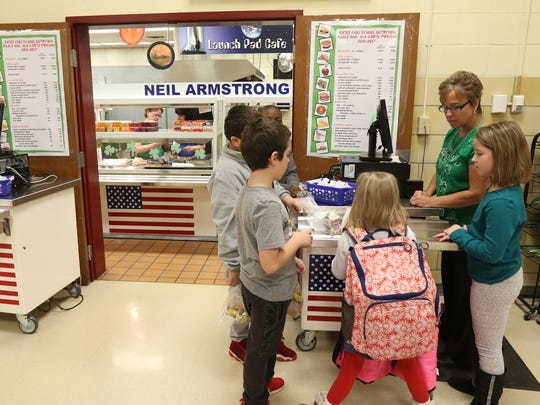 Karen Higgins works the register at Gates Chili's Neil Armstrong Elementary School as the students use their accounts to cash out their breakfasts.