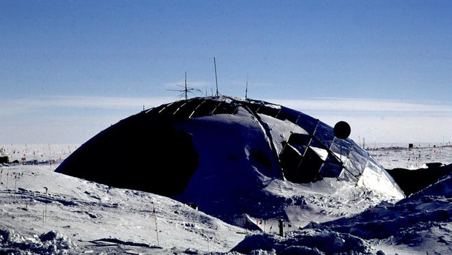 ADVANCE FOR SUNDAY, DEC. 27--The 5-story geodesic dome of the South Pole station looms from the landscape in December 1997,  where snow has covered it gradually since it opened in 1975. A new $153 million station is slated to open in 2005.  (AP Photo/Eric Baker)