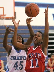 Irvin's Kayla Thorton goes for the rebound against