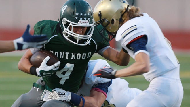 Montwood's Alex Cepeda runs for yardage as he runs into Coronado defender Gustavo Holcombe Thursday.