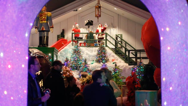 Santa and one of his helpers wave to the crowd as they enter the last room at Castle Noel on December 1, 2016, in Medina, Ohio. America's largest collection of holiday movie-related artifacts continues to grow everyday according to Mark Klaus, who is continuously adopting new items and displays to build on the museum.
