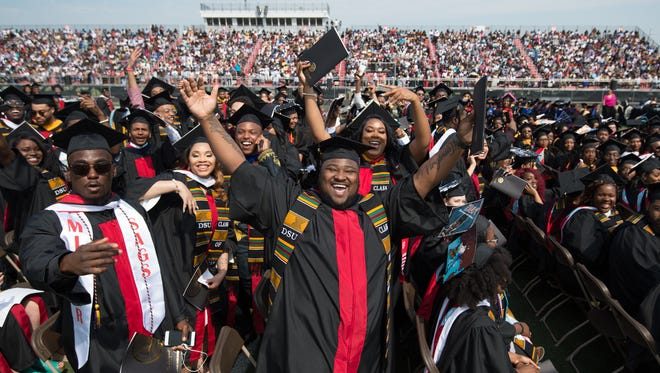 Students pose for a photo at the Delaware State University 132nd commencement ceremony where over 700 graduates took part in the ceremony.