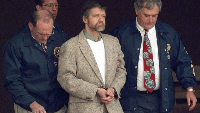 FILE - In this June 21, 1996, file photo, Theodore Kaczynski looks around as U.S. marshals prepare to take him down steps at the federal courthouse to a waiting vehicle in Helena, Mont.
