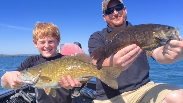 Tyler and Jesse Bohn with a pair of nice Chequamegon Bay smallies