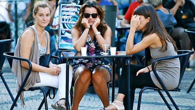 """Challenge: Photo-Women: """"Three Different Reactions Facing a Photographer,"""" by Pedro Ribeiro Simoes."""