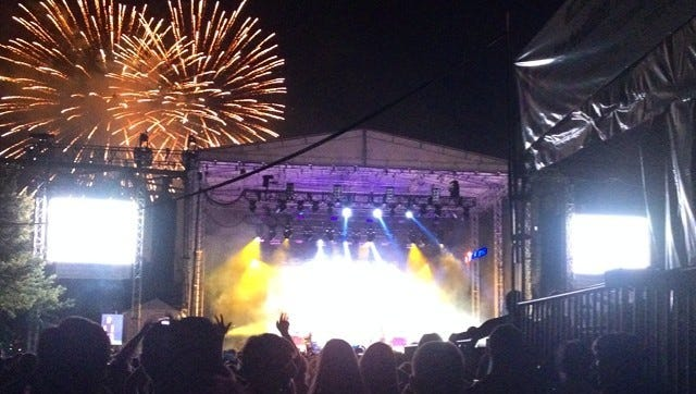 Post-Reds game fireworks explode over the stage as Empire of the Sun performs at Bunbury Music Festival.