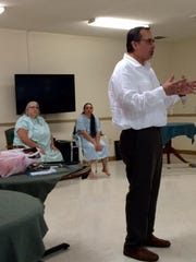 Michael Faulkner of Engaged Behavioral Health addresses an in-service workshop for certified nurses aides at Emerald Ridge Rehabilitation and Care Center this summer. Faulkner, who advocates for patients to be more assertive and involved in their care, had the CNAs engage in play-acting to demonstrate good care techniques.