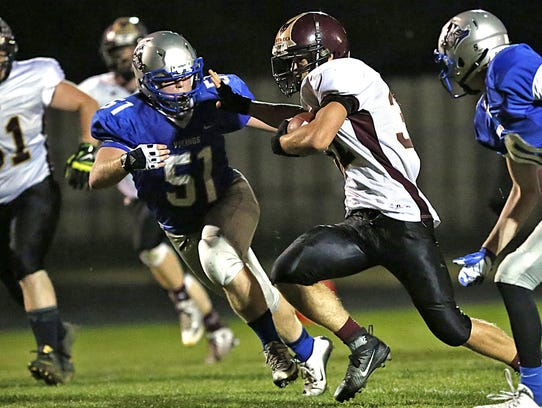 WLA's Tanner Haase moves in for a tackle  in a game