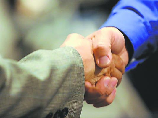 636092580865449601-handshake-crop3.jpg